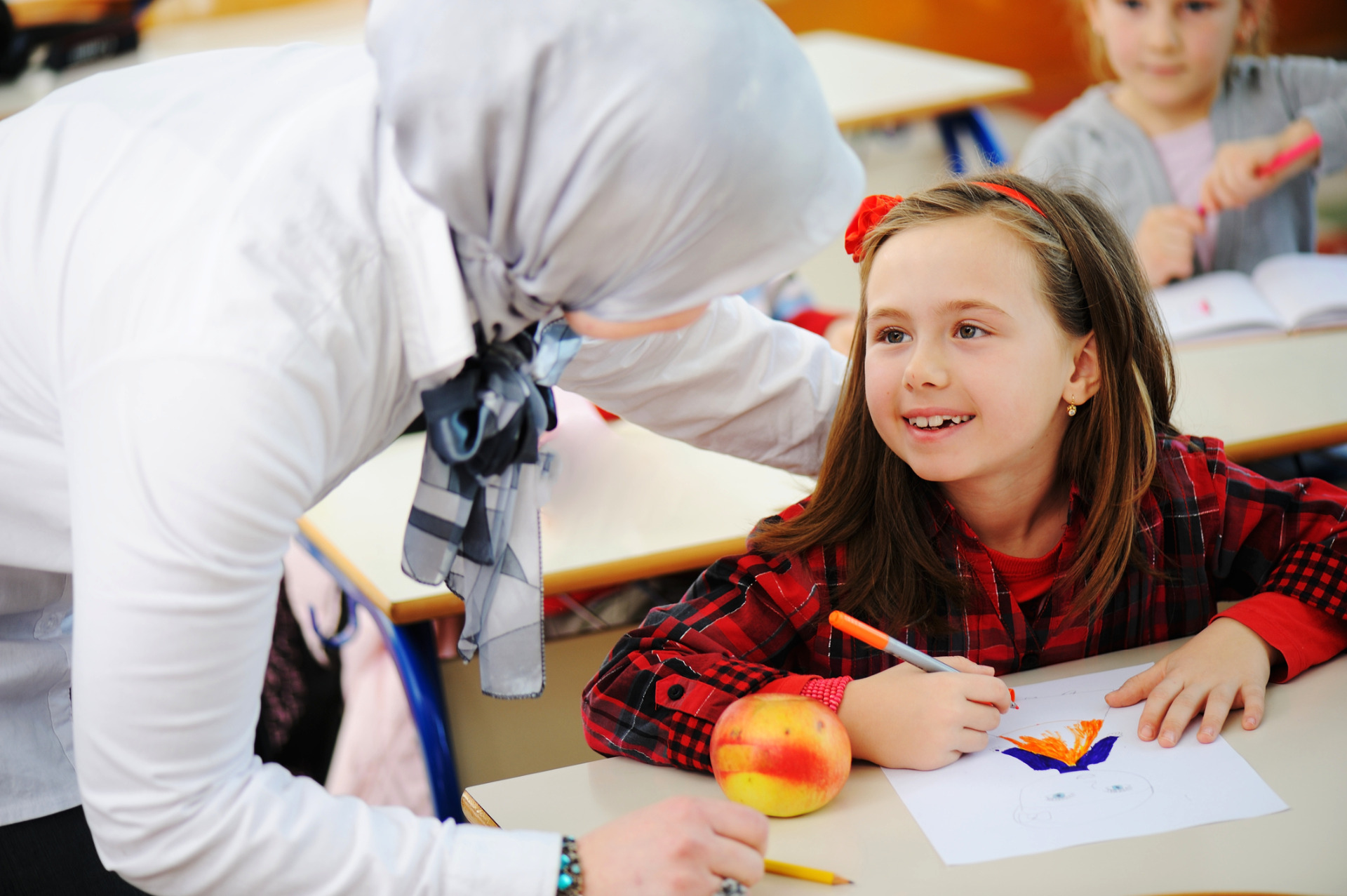 Expat School in Oman, child and teacher
