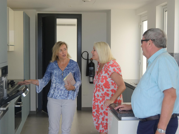 Dee Walker of Reloglobal helping a couple settle in their new apartment in Muscat Oman.